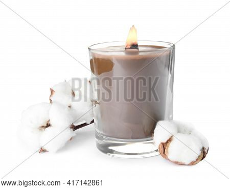Beautiful Candle With Wooden Wick And Cotton Flowers On White Background