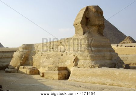 Majestic Sphinx And One Of Gizah Pyramids In Cairo, Egypt.