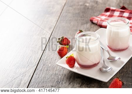 Panna Cotta Dessert With Strawberry On Wooden Table. Copy Space