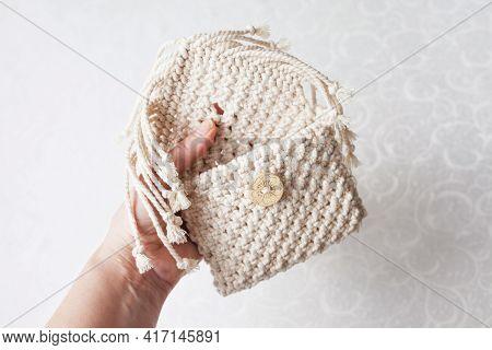 Handmade White Macrame Bag In Woman Hands, Eco Friendly. Hobby Knitting Handmade Macrame. Modern Sum