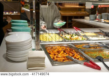 Side Dishes On The Serving Line, Self-service Restaurant. Steamed Vegetables, Rice, Buckwheat, Potat