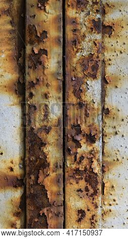 Rusted White Painted Metal Wall. Rusty Metal Background With Streaks Of Rust. Rust Stains. The Metal