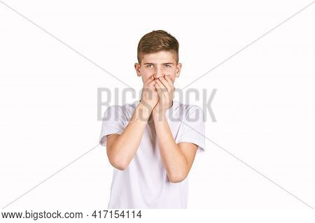 Children Portrait In White T-shirt. Studio Isolated Concept. Oops Emotion. Male Person Frustration.