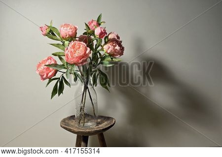 Peony Flowers In Vintage Vase And Shadows