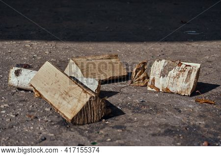 Stack Of Felled Logs With Bark, Lie On The Asphalt. A Birch Stack For A Campfire. Rest In Nature. Se