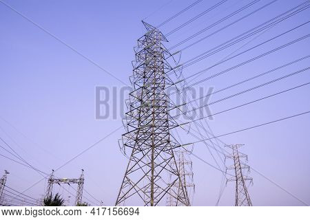 Electricity Power Plant Substation In The Morning Light, Transmission Line Of Electricity To Rural F