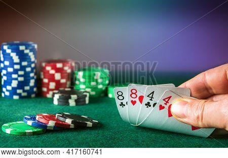 Poker Cards With Full House Or Full Boat Combination. Close Up Of Gambler Hand Takes Playing Cards I