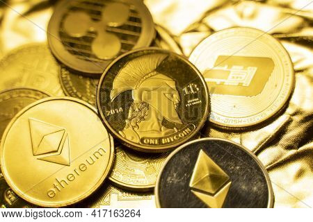 Gold Crypto Coins On A Golden Background. Trading On The Cryptocurrency Exchange. Cryptocurrency Sto