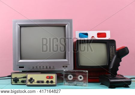 Retro Portable Mini Tvs, Joystick, Gamepads, 3d Glasses On Pink Background. Attributes 80s, Retro Me