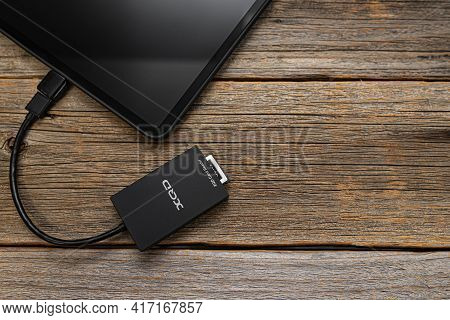 Uzhgorod, Ukraine - April16 , 2021: Apple Ipad Pro With An Xqd Memory Card Connected Via Otg Via A C