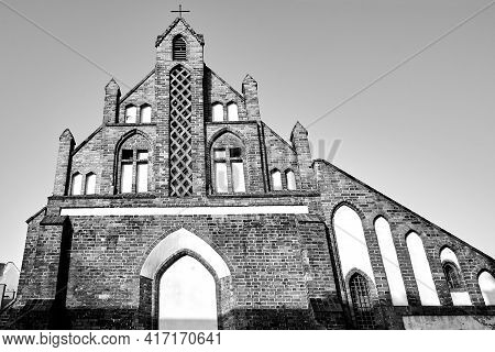 A Facade Of Medieval Catholic Church  In Poznan, Monochrome