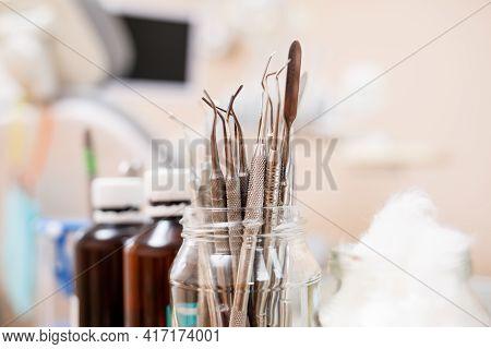 Dentist Dental Instruments On The Medical Table. Laboratory Instrument For Dental Treatment. Prosthe