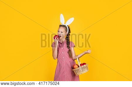 Cheerful Bunny Kid Bite Apple. Harvest. Happy Easter Holiday. Funny Child Hold Apple Basket.