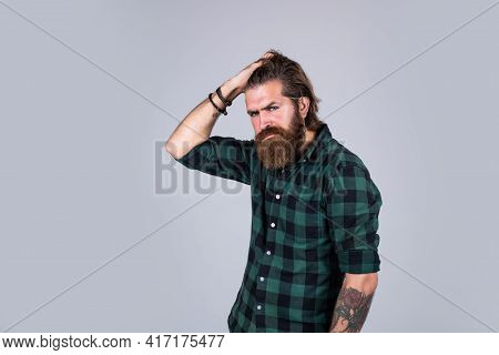Casual Fashion Style. Modern Looking Bearded Hipster. Hairdresser Concept. Brutal Handsome Man With