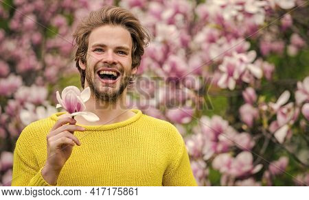 Male Beauty. Hipster Enjoy Blossom Aroma. Spring Beauty. Hairdo Styling. Man Flowers Background Defo