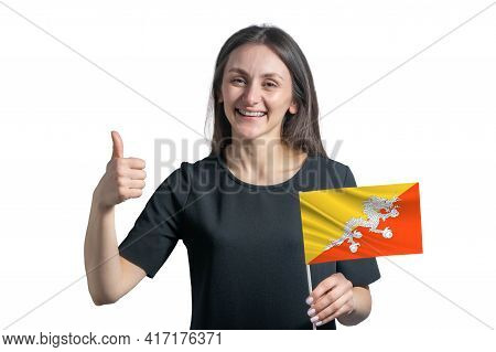 Happy Young White Woman Holding Flag Of Butane And Shows The Class By Hand Isolated On A White Backg