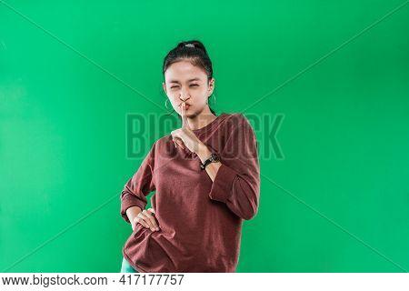 Portrait Asian Woman Wearing Sweater Showing Shh Gesture