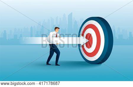 Businessman Aims With Huge Arrow. Achievement Goal. Aim In Business Concept
