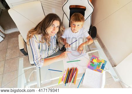 Back To School, Mom And Son Doing Lessons At Home, Quarantine Time, Coronavirus Pandemia Lifestyle
