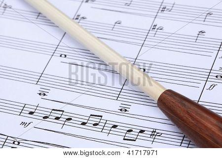 Conductor's Baton and Music Score