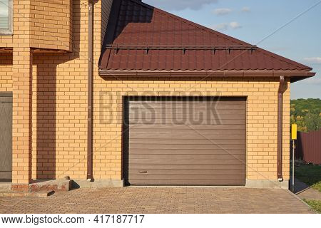 Garage With Automatic Garage Door Attached To The House.