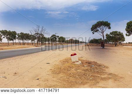 Desert Road, Dry Salt Lake Chott El Djerid In Tunisia. Desert Around Lake With Blue Sky Without Clou