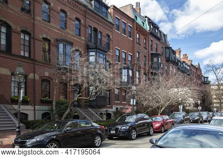 Boston, Ma - April 8 2021: Rows Of Brownstone Apartment Brick Buildings In Boston With Front Yards,