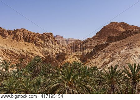 View Of Atlas Mountains In Tunisia. Against The Background Of Blue Sky.