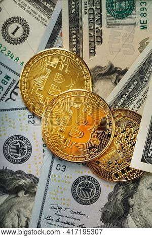 Bitcoin Gold Coins On Us Dollar Bills.