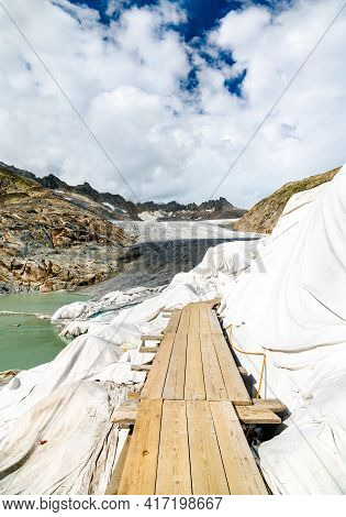 The Rhone Glacier, The Source Of The Rhone River At Furka Pass In The Swiss Alps