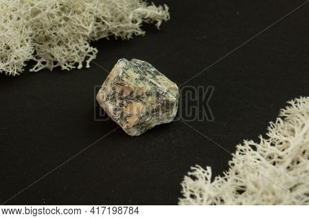 Dendrite Manganese Oxides From Morocco. Natural Mineral Stone On A Black Background Surrounded By Mo