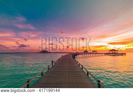 Water Villas Wooden Pier, Stunning Colorful Sunset Sky With Clouds On The Horizon Of Maldives Island