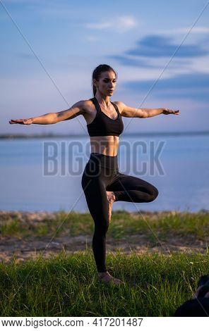 Sports Girl Doing Yoga On The Beach. Girl With Exercise Mat