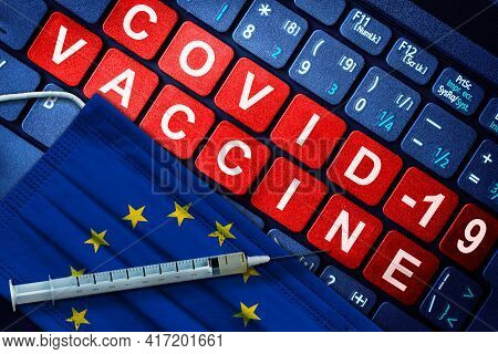 Covid-19 Immunization In European Union Showing Syringe And Face Mask With Eu Flag And Vaccine Messa