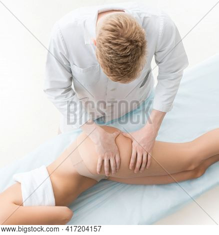 Anonymous Man Massaging Thigh Of Crop Woman