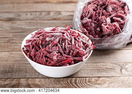 Frozen Beet In A White Plate On A Wooden Table. Frozen Food, Frozen Vegetables.