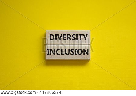 Diversity And Inclusion Symbol. Wooden Blocks With Words 'diversity, Inclusion' On Beautiful Yellow