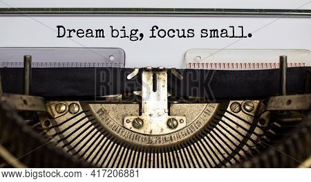 Dream Big Focus Small Symbol. Concept Words 'dream Big Focus Small' Typed On Retro Typewriter. Busin
