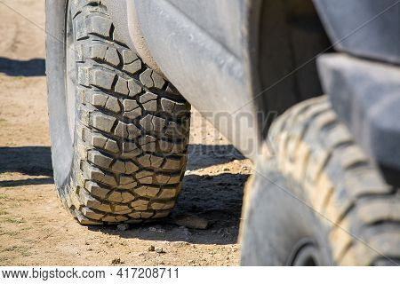 Off-road Tires With Rough Tread For Off-road Driving On Country Dirt Roads Close-up Of A Dirty Car C