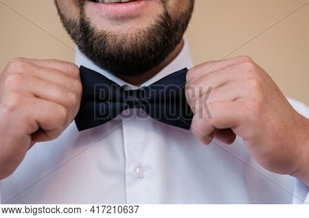 Blue Bow Tie In The Hands Of The Groom. Bow Tie In The Hands Of A Man