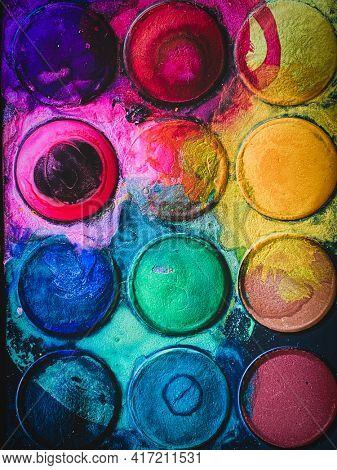 Colorful Watercolor paint palette set in circles dirty, Hobby