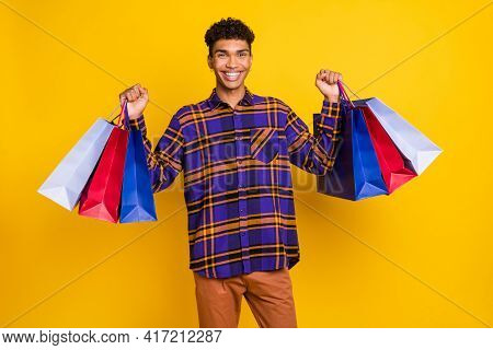 Photo Of Young Cheerful Black Guy Happy Positive Smile Hold Shopping Bags Black Friday Isolated Over
