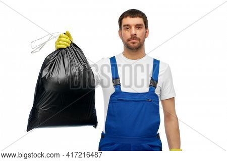 profession, cleaning service and people concept - male worker or cleaner in overall and gloves with garbage bag over white background