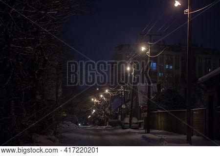 Pancevo, Serbia - January 17, 2021: Selective Blur On A Road Of Residential Street Of Pancevo, Vojvo