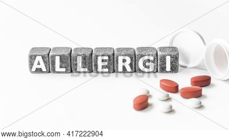 The Word Aesthetician Is Written Near Pills On A Light Blue Background. Medical, Health And Happines