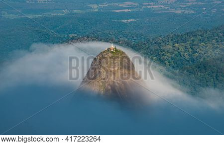 Spectacular View Of Doi Nork Covered With The Mist, An Iconic Huge Grey Black Rock In Doi Luang Nati