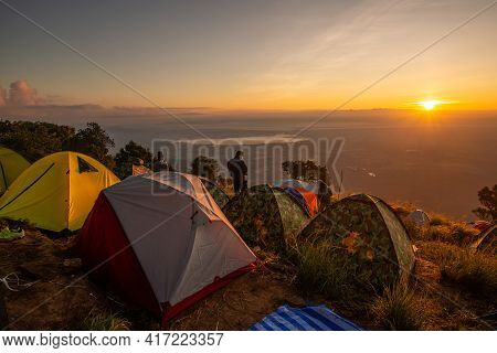 Sunrise View With Tourist Tent Camping On The Edge Of Doi Luang Phayao National Park In Winter Seaso