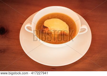 French Onion Soup In The Lyon Style - Soupe à L'oignon Lyonnaise (or Gratinée Lyonnaise) In A White