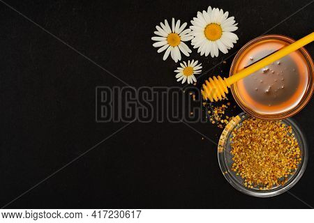 A Yellow Spoon Of Honey Dipped In A Jar Of Honey And Bee Bread Scattered On A Black Background Decor
