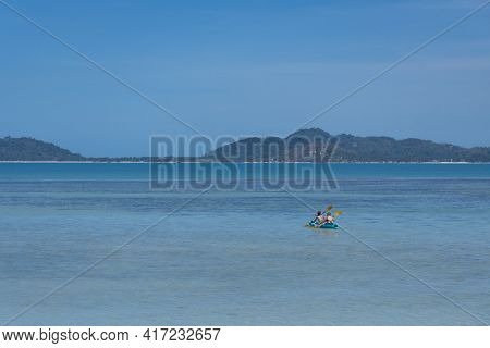 Tourist Is Kayaking At The Koh Samui, During Summer Time In Thailand.